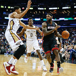 Mar 22, 2014; New Orleans, LA, USA; Miami Heat forward LeBron James (6) is defended by New Orleans Pelicans forward Anthony Davis (23) during the third quarter of a game at the Smoothie King Center. The Pelicans defeated the Heat 105-95. Mandatory Credit: Derick E. Hingle-USA TODAY Sports