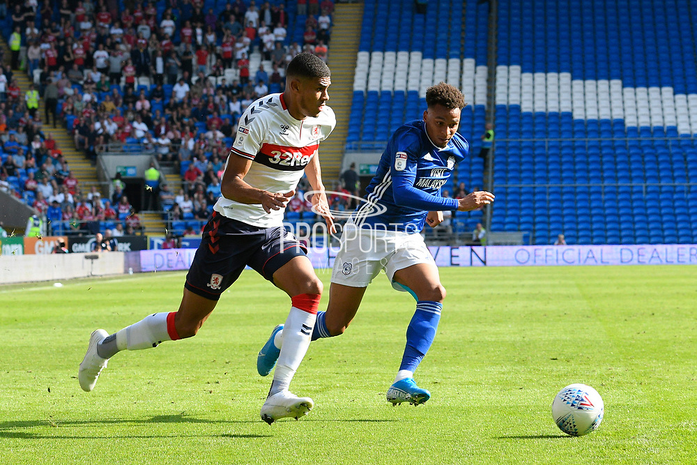 Ashley Fletcher (11) of Middlesbrough on the attack chased by Josh Murphy (11) of Cardiff City during the EFL Sky Bet Championship match between Cardiff City and Middlesbrough at the Cardiff City Stadium, Cardiff, Wales on 21 September 2019.
