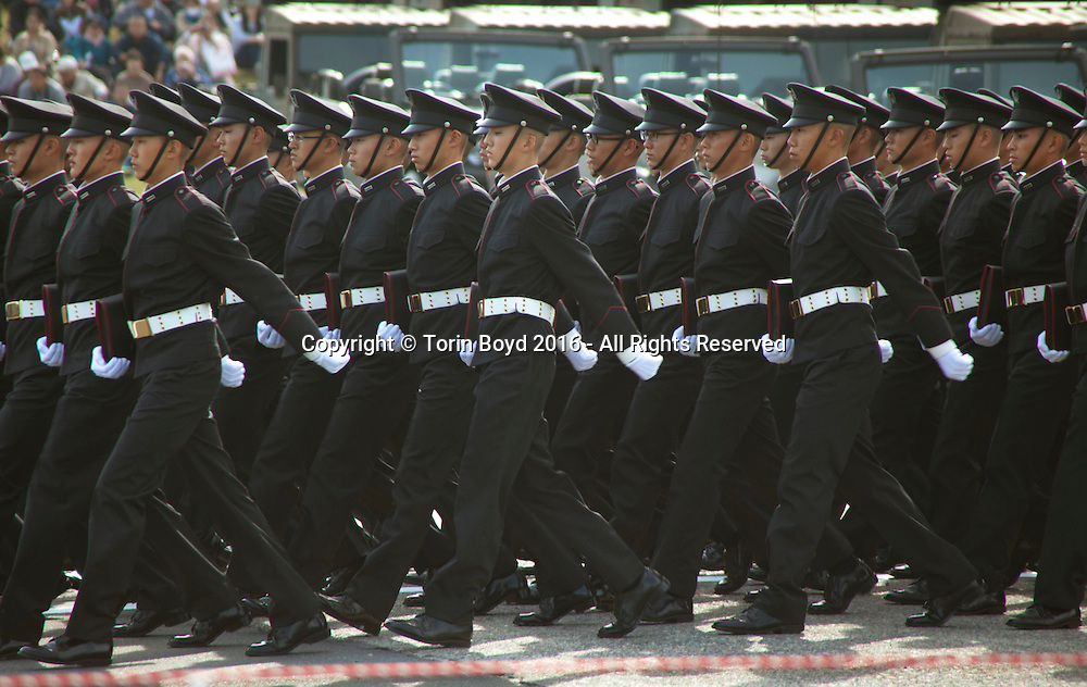 """October, 23, 2016, Asaka, Saitama Prefecture, Japan: Cadets from the Ground Self Defense Force's """"High Technical School"""", march in formation during the annual military review held at the Asaka Training Area, a Japan Ground Self Defense Force (JSDF) base on the outskirts of Tokyo. For this event, Prime Minister Shinzo Abe, top ranking Japanese brass and international dignitaries were in attendance to view Japan's military might. This included 4000 troops, 27 divisions, 280 vehicles and artillery, plus 50 aircraft of the Ground, Air, and Maritime branches of the JSDF. (Torin Boyd/Polaris)."""