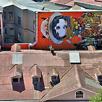 Sideways Ekeko Mural by INTI in Valparaíso, Chile <br />