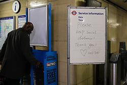 © Licensed to London News Pictures. 17/03/2020. London, UK. 'Please keep social distance! Thank you!' sign on display at Manor House station. London Transport will reduce weekday services during the coronavirus crisis to a weekend level of service. Photo credit: Dinendra Haria/LNP
