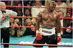 28 June 1997:  Evander Holyfield grimmaces in pain after Mike Tyson bites Holyfield's ear in their second fight at the MGM Grand in Las vegas, NV..Mandatory Credit:  VJ Lovero/Icon SMI