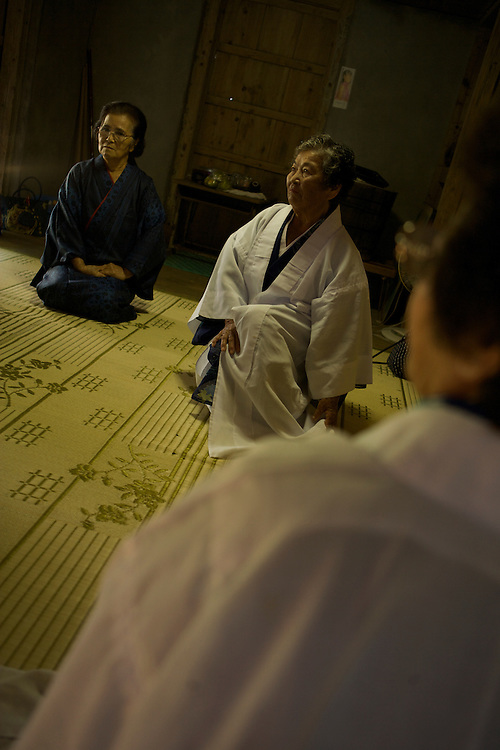 Chiyo Ameku, 78, says her ikigai--or reason living--is her role as a noro, or priestess, of her village in Motubu. On the first and fifteenth of each month, she offers formal prayers to ancestors for the safety, health, and happiness of her people..Chiyo Ameku sits with two other priestesses, Igami, right, and Negami, left. Leadership positions in the Okinawan religion are passed down through maternal lines...Today we had an equally rare opportunity to see a noro, or priestess, do a ceremony. These are normally incredibly private rituals done just for the family or for the community. We found ourselves sitting right in the middle of it. ..Okinawans believe that women possess a special sense or an ability to communicate with the gods. But actually the genesis of noro goes back about 400 years when the king made women religious leaders to divest powers away from men...Translator: First she prayed toward that shrine in regards to the health of the children and abundant harvest for the whole village. ..Dan: What happens if they miss these prayers?..Translator: It's not a matter of what will happen or this and that. It's just that this is my duty that I have been given from my ancestors. ..Dan: I asked her if there was any kind of connection between Okinawan longevity and her religion and she said absolutely. She pointed to the fact that when people who leave the village, lose the religion, move to the big city, they often get sick. And when they come back, she counsels them to get back into the religion, continue to do the prayers to the ancestors. And she recounted time and time again these people would get better. Whether it's a psychosomatic response or whether there's some religious explanation, we didn't know...What we do know is that there are scores of scientific studies that show there is a connection between religiosity and longevity. Perhaps the most convincing one was done out of Duke University that showed that people who go to church at least four times a m