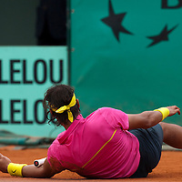 31 May 2009: Rafael Nadal of Spain lies on the court after falling during the men's Singles fourth round match on day eight of the French Open at Roland Garros in Paris, France.