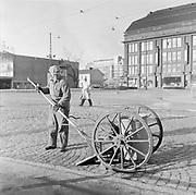 Male cleaner worker sweeping street Helsinki, Finland 1995