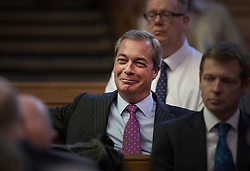© Licensed to London News Pictures. 28/11/2016. London, UK. Former party leader Nigel Farage sits in the audience as Paul Nuttall is announced as the new leader of the UK Independence Party (UKIP), at the Emmanuel Centre in Westminster London. Photo credit: Peter Macdiarmid/LNP
