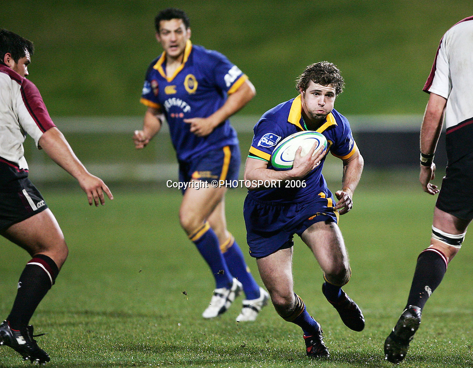 Otago first five Nick Evans looks for a gap during the Air New Zealand Cup pre season game between QBE Insurance North Harbour and Speight's Otago held at North Harbour Stadium in Auckland, New Zealand on Friday 14 July 2006. Photo: Tim Hales/PHOTOSPORT