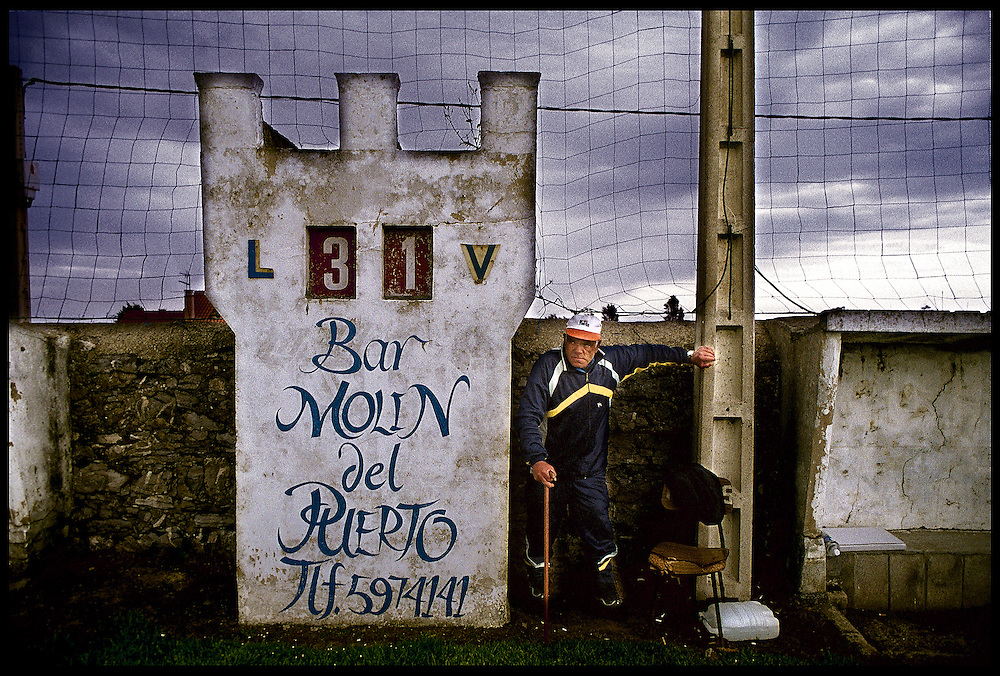 Podes, Asturias, Spain.An older man next to football field marker in Podes, a small villlge in the north o Spain.© Carmen Secanella.