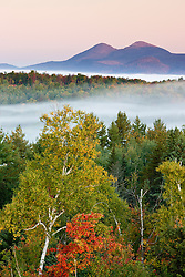 Morning fog and the Percy Peaks as seen from the fire tower at Milan Hill State Park in Milan, New Hampshire.