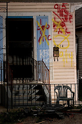 10 December, 05. New Orleans, Louisiana. Post Katrina aftermath. <br /> One dead in attic. The front porch of a house on St Roch in Gentilly where sadly a victim of the storm perished.<br /> Photo; &copy;Charlie Varley/varleypix.com