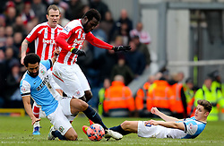 Lee Williamson of Blackburn Rovers tackles Stoke City's Mame Biram Diouf -  Photo mandatory by-line: Matt McNulty/JMP - Mobile: 07966 386802 - 14/02/2015 - SPORT - Football - Blackburn - Ewood Park - Blackburn Rovers v Stoke City - FA Cup - Fifth Round