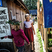 "At the entrance of traditional music summer camp for children; in the panel is written ""it is begged to hold closed the umbrellas during the performance"""