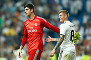 Real Madrid's Belgian goalkeeper Thibaut Courtois gestures with Real Madrid's German midfielder Toni Kroosduring the Spanish championship Liga football match between Real Madrid CF and Leganes on September 1, 2018 at Santiago Bernabeu stadium in Madrid, Spain - Photo Benjamin Cremel / ProSportsImages / DPPI