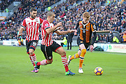 Southampton midfielder Oriol Romeu (14)  tries to stop Hull City midfielder Sam Clucas (11)  during the Premier League match between Hull City and Southampton at the KCOM Stadium, Kingston upon Hull, England on 6 November 2016. Photo by Simon Davies.