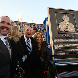 The Dodgers long time Hall of Fame broadcaster Vin Scully was honored during pre-game ceremonies for his six-decades of service to the Dodgers with a commemorative bronze plaque at the peristyle entrance to the coliseum. Scully called games at the coliseum from 1958-1961 and his 59 years of service is a Major League Record. The Dodgers celebrating there 50th season in Los Angeles played an exhibition game against the Boston Redsox's March 29. 2008 at the Los Angeles Memorial Coliseum. (SGVN/Staff Photo Keith Birmingham/SXSports)