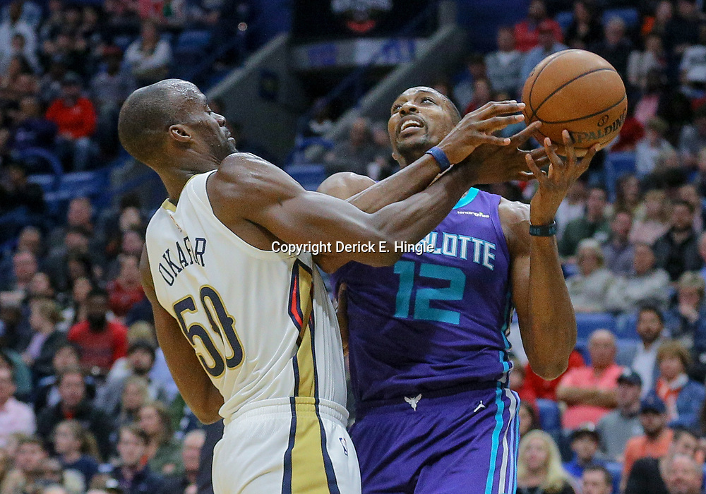 Mar 13, 2018; New Orleans, LA, USA; New Orleans Pelicans center Emeka Okafor (50) defends against Charlotte Hornets center Dwight Howard (12) during the second quarter of a game at the Smoothie King Center. Mandatory Credit: Derick E. Hingle-USA TODAY Sports