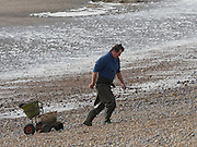 Man collecting worms, Pett Level beach, 20 October 2016