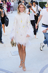 Celine Dion arrives at Valentino fashion show during Haute Couture Fall/Winter 2019-2020 in Paris on July 03, 2019. Photo by Nasser Berzane/ABACAPRESS.COM  Blanc Blanche Couleur blanche Blanches White Candid Pap Planque Plume Plumes Feather Robe courte Robes courtes Short Dress Besace Sac a main Sacs a main Purse Purses Bags  | 690476_166 Paris France
