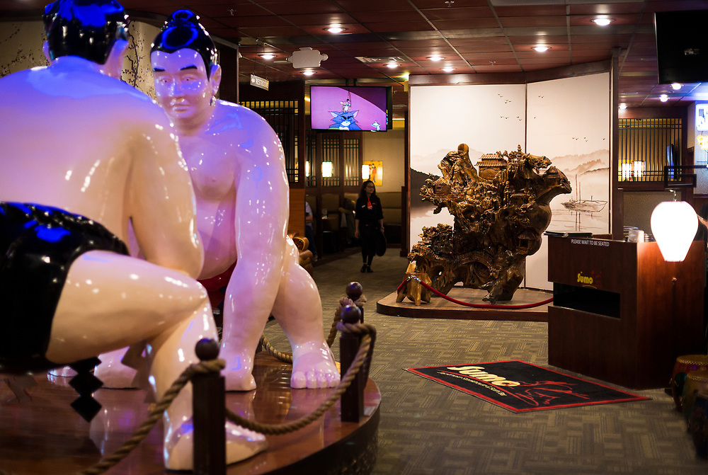 The entrance to Sumo Japanese Steakhouse & Sushi Bar in Madison, Wisconsin features two large sumo figures as well as a large carved wooden statue, Wednesday, March 21, 2018.