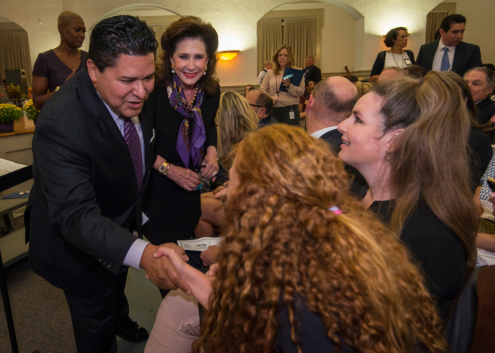 Houston ISD Superintendent Richard Carranza greets the Lanier family before a renaming ceremony at Bob Lanier Middle School, September 21, 2016.