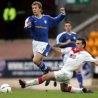 St Johnstone v Airdrie..23.10.04<br />Lee Hardy is tackled by Stephen Docherty<br /><br />Picture by Graeme Hart.<br />Copyright Perthshire Picture Agency<br />Tel: 01738 623350  Mobile: 07990 594431
