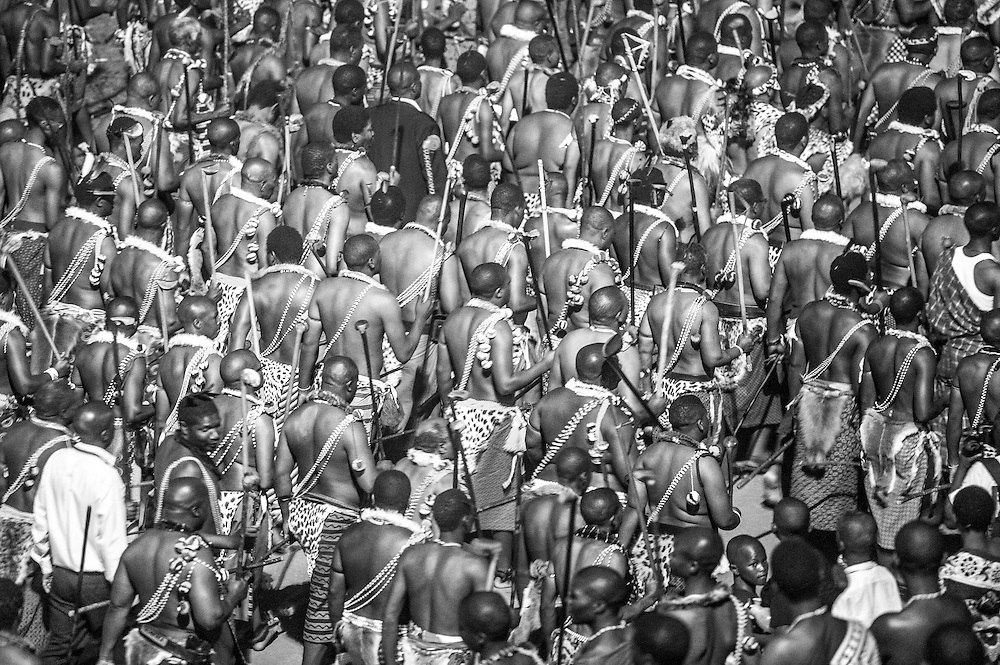 Ludzidzini, Swaziland, Africa - Annual Umhlanga, or reed dance ceremony, in which up to 100,000 young Swazi women gather to celebrate their virginity and honor the queen mother during the 8 day long event.<br /> Warriors leaving the dancing grounds