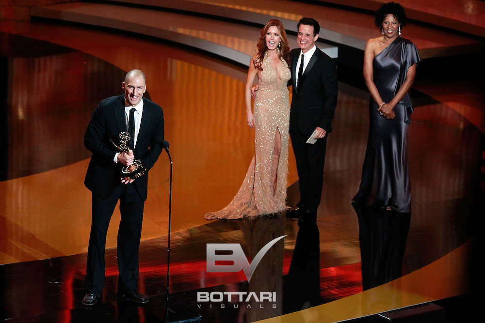 From left, TV show host Ben Bailey accepts the Outstanding Game Show Host award from actors Tracey E. Bregman and Christian LeBlanc onstage during the Daytime Emmy Awards on Sunday June 19, 2011 in Las Vegas. (AP Photo/Jeff Bottari)