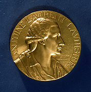 Antoine Laurent Lavoisier  (1743-1794) French chemist. Among other achievements, he was one of the discoverers of oxygen, and established the laws of chemical combination. He improved the manufacture of gunpowder when director of government powder mills. He was guillotined during the French Revolution. Obverse of a commemorative medal.
