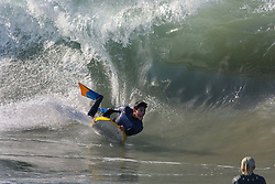 July 6, 2018 - Newport Beach, California, U.S. - At a surf sport known as 'the Wedge' a body boarder takes advantage of the cool water and big waves hitting Southern California. Record-breaking temperatures are hitting Southern California Friday. (Credit Image: © Charlie Neuman via ZUMA Wire)