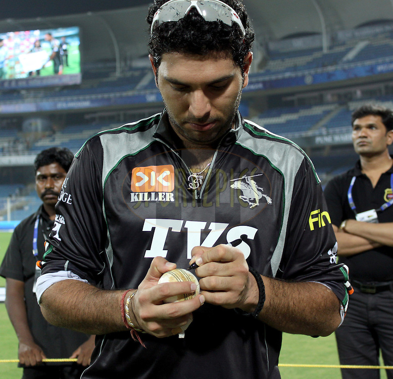 Pune Warriors captain Yuvraj Singh signs the Vodafone ball during  match 5 of the Indian Premier League ( IPL ) Season 4 between the Pune Warriors and the Kings X1 Punjab held at the Dr DY Patil Sports Academy, Mumbai India on the 9th April 2011..Photo by Sandeep Shetty/BCCI/SPORTZPICS