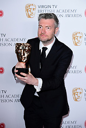 Charlie Brooker with the award for Best Comedy and Comedy Entertainment Programme in the press room at the Virgin TV British Academy Television Awards 2017 held at Festival Hall at Southbank Centre, London. PRESS ASSOCIATION Photo. Picture date: Sunday May 14, 2017. See PA story SHOWBIZ Bafta. Photo credit should read: Ian West/PA Wire