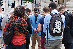 London, August 20th 2014. In the wake of the execution of American journaist James Foley, a small group of Christians hold a prayer vigil and protest outside the gates of Downing Street, against the murder of thousands of Christians, Yezidis and minority groups by Islamic State Jihadists.