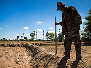 02 JUNE 2016 - SIEM REAP, CAMBODIA: A farmer repairs the dikes in his rice fields near Seam Reap. Cambodia is in the second year of  a record shattering drought, brought on by climate change and the El Niño weather pattern. Farmers in the area say this is driest they have ever seen their fields. They said they are planting because they have no choice but if they rainy season doesn't come, or if it's like last year's very short rainy season they will lose their crops.      PHOTO BY JACK KURTZ