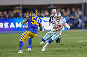Jan 12, 2019; Los Angeles, CA, USA;  Dallas Cowboys quarterback Dak Prescott (4) is defended by Los Angeles Rams outside linebacker Samson Ebukam (50) during an NFL divisional playoff game at the Los Angeles Coliseum. The Rams beat the Cowboys 30-22. (Kim Hukari/Image of Sport)