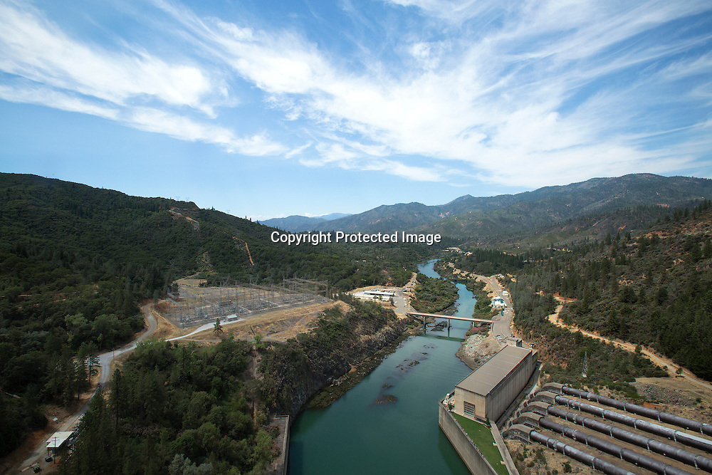View of the Sacramento River from Shasta Dam whose outflow provides electricity and flood control of the Sacramento River and the Sacramento Valley. It is also part of the Cental Valley Project and irrigation water.