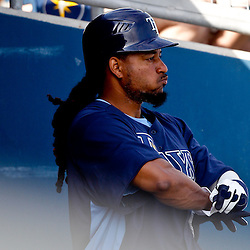 February 25, 2011; Port Charlotte, FL, USA; Tampa Bay Rays left fielder Manny Ramirez (24) during a spring training split squad scrimmage at Charlotte Sports Park.  Mandatory Credit: Derick E. Hingle