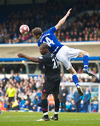 BIRMINGHAM, ENGLAND - Saturday, March 13, 2010: Everton's Ayegbeni Yakubu and Birmingham City's Roger Johnson during the Premiership match at St Andrews. (Photo by David Rawcliffe/Propaganda)