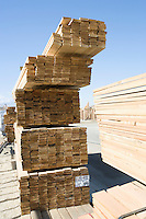 Stacks of planks for new house