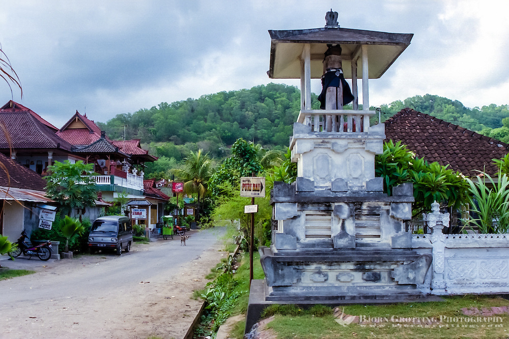 Bali, Karangasem, Padangbai. Most of the restaurants and accommodation are located along the narrow streets by the beach. The city is surrounded by green hills well suited for hiking.