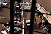 Immigration and Customs Enforcement (ICE) officers search a vehicle as it crosses into the U.S. in San Ysidro, Calif. on Saturday, March 26, 2005.<br />