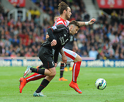 Stoke City's Marko Arnautovic and Liverpool's Adam Lallana battle for the ball - Photo mandatory by-line: Nizaam Jones/JMP - Mobile: 07966 386802 - 24/05/2015 - SPORT - Football - Stoke - Britannia Stadium - Stoke City v Liverpool - Barclays Premier League