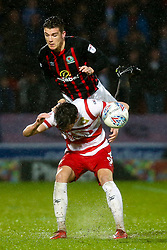 Darragh Lenihan of Blackburn Rovers challenges John Marquis of Doncaster Rovers - Mandatory by-line: Robbie Stephenson/JMP - 24/04/2018 - FOOTBALL - The Keepmoat Stadium - Doncaster, England - Doncaster Rovers v Blackburn Rovers - Sky Bet League One