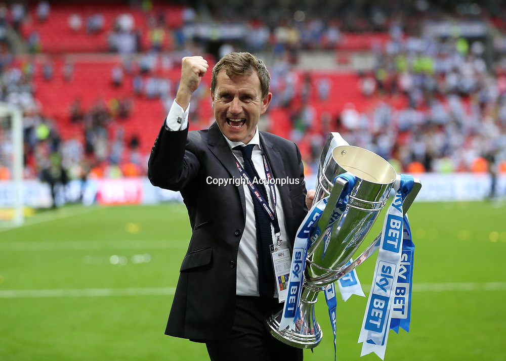 May 29th 2017, Wembley Stadium, London, England; EFL Championship playoff final, Huddersfield Town versus Reading; Huddersfield Town Chairman Dean Hoyle celebrates towards the Huddersfield Town fans with the EFL Championship playoff final trophy