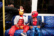 UNITED KINGDOM, London: 25 May 2018. Levi Anderson (left, aged four) and Khalil Loy (right, aged four) make their way to the MCM London Comic-Con this afternoon on the London Underground. The three day comic convention, which is held at London's ExCeL, will see thousands of visitors many of them in cosplay, dressed as their favourite super hero, villain or comic book character. Rick Findler  / Story Picture Agency