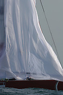 Italy's Capitalia foredeck crew pulls down spinnaker at end of  America's Cup fleet race; Valencia, Spain.