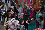 Muslim family out shopping in clothes shop in city of Varanasi, Benares, Northern India