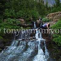 dramatic yoga pose near alpine waterfall