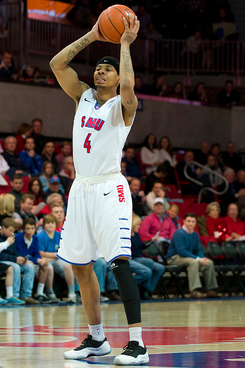 DALLAS, TX - JANUARY 21: Keith Frazier #4 of the SMU Mustangs brings the ball up court against the Rutgers Scarlet Knights on January 21, 2014 at Moody Coliseum in Dallas, Texas.  (Photo by Cooper Neill/Getty Images) *** Local Caption *** Keith Frazier