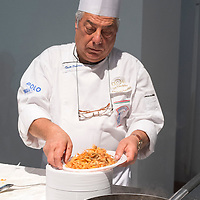 A chef prepares some fried fish during the Biennale del Gusto. The Biennale del Gusto is an exhibition held over four days, dedicated to traditional food and drinks from all regions of Italy.