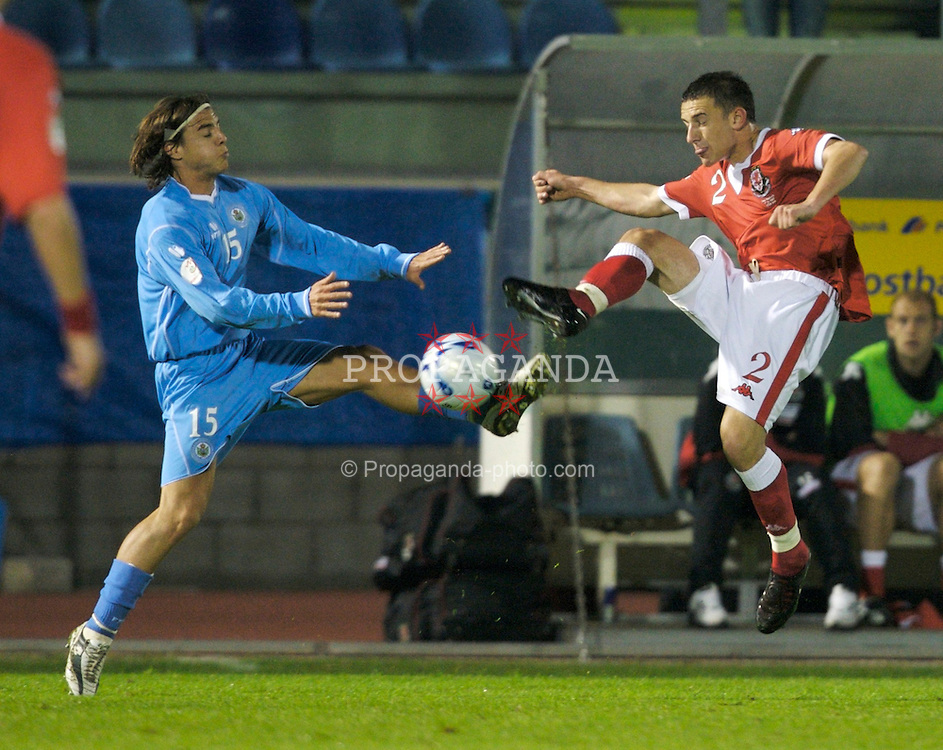 San Marino, San Marino - Wednesday, October 17, 2007: Wales' Neal Eardley and San Marino's Giovanni Bonni during the Group D UEFA Euro 2008 Qualifying match at the Serravalle Stadium. (Photo by David Rawcliffe/Propaganda)